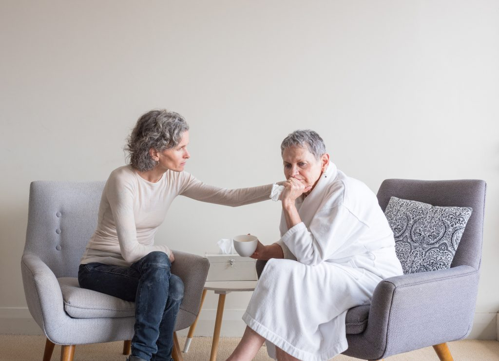 Adult Child with Anxious Elderly Mother