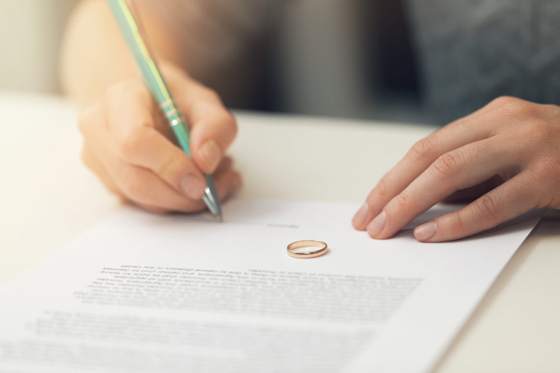 Woman Signing Marriage Documents