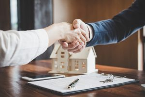 Real estate lawyer and customers shaking hands Allen Gabe Law P.C.