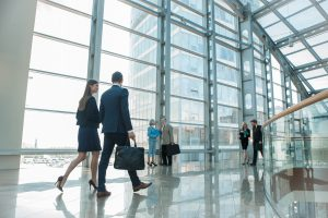 Business Professionals Walking in Building
