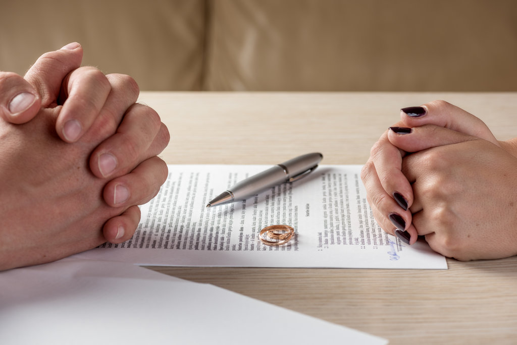 Couple Signing Divorce Papers